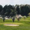 A spring day view of a hole at Elms Country Club.