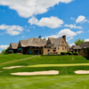 A view of a green and the clubhouse at Springfield Country Club.