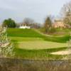 A spring day view of a hole at Cooks Creek Golf Club.