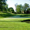 A sunny day view of a hole at Clovernook Country Club.