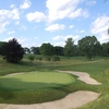 A view of the par-3 5th green surrounded by bunkers at Moraine Country Club