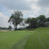 A view of hole #18 protected by bunkers and the clubhouse on the right side at Toledo Country Club.