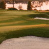 Sunset view of a green and bunkers at White Springs Golf Club