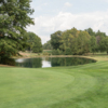 A view of a green with water in background at Pine Brook Golf Links