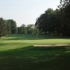 A view of a green protected by a bunker at Turtle Creek Golf Course