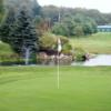 A view of a green surrounded by water at Edgewater Golf Club