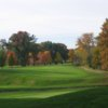 A view of a fairway with a narrow cart path on the right side at Elyria Country Club