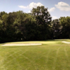 A view of a green protected by bunkers at Stillwater Ridge Golf Course