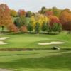 A view of a green protected by bunkers at Shady Hollow Country Club