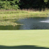 A view of a green with water coming into play at Beechmont Country Club
