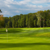 A sunny day view of a hole at Quail Hollow Country Club.