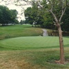 A view of the 16th hole with cart path in background at Blackhawk Golf Club
