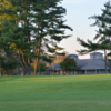 A view of a hole and the clubhouse at Twin Run Golf Course.