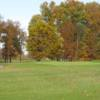A fall day view of a hole at Dragon Ranch Golf Club.