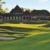 A view of a green and the clubhouse at Pinnacle Golf Club.