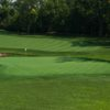 A sunny day view of a hole at Pinnacle Golf Club.
