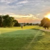 A sunset view of a green at Beckett Ridge Country Club.