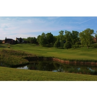 A pond defines the 18th hole at Deer Run Country Club in Cincinnati.