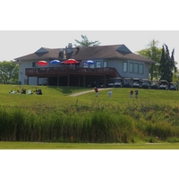 Golfers tee off on the 10th tee in the shadow of the clubhouse at Deer Run Country Club in Cincinnati.