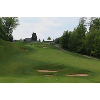 The 10th hole at Aston Oaks Golf Club climbs a hill to the green.